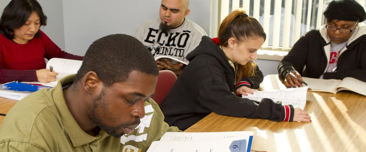 Diverse group of students in classroom studying